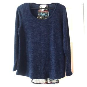 Navy blue sweater with shear multicolored detail